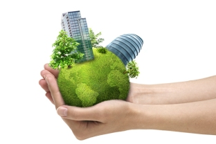 Human hands holding green planet with urban city